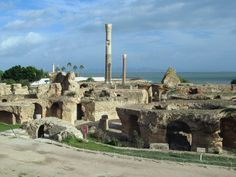 The seaside Thermes d'Antonin at Carthage, Tunis, Tunisia, were among the largest in the Roman Empire. One of the eight columns once used to support the vaulted roof has been restored. 7 Continents, Roman Empire, Monument Valley, Seaside, Mount Rushmore, Places To Visit, Africa, Mountains, Travel