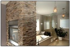Rinaldi Homes - 2-way cultured stone, gas fireplace in ensuite bathroom