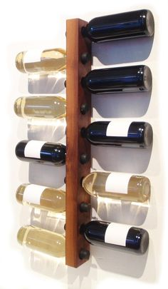 "Handmade walnut wine rack.  I want to get two and line them up next to each other on the wall to create a ""zippered"" look.  Wine rack and art piece, all in one.  Perfect for that blank wall in my kitchen/dining room."
