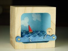 Our handmade wooden, kinetic boat sculptures cause even the busiest among us to slow down. Turn the crank and watch the little boat sail on the
