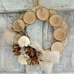 Dad's workshop/garage door?  Pretty wood wreath  Too bad Mom and Dad never saved all of their trunk bottoms! They'd have a few wreaths like this :)