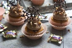 Pumpkin Snickers Cupcakes with Chocolate Buttercream and Edible Spiderwebs - Cooking for Keeps