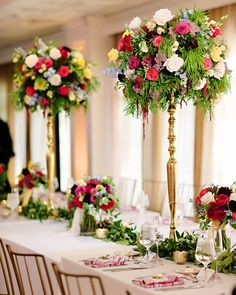 Beautiful centerpieces on this head table at a wedding reception at Black Iris Estate in Carmel Indiana
