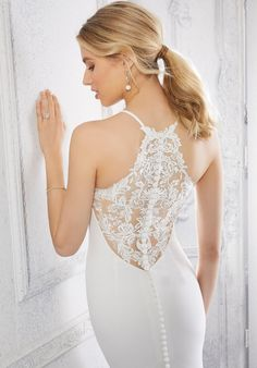 The stretch crepe fit and flare wedding dress features a sleeveless bodice with a v-neckline and sheer lace back. Stunning Wedding Dresses, Bridal Wedding Dresses, Fit And Flare Wedding Dress, Mori Lee, Lace Back, Bodice, Neckline, Dream Dress, Collection