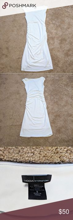 """EUC Moda International White Dress Size Small Excellent Used Condition Discontinued Moda International White Dress Size Small  They need to make more clothes with quality like this!  Worn only once to my high school graduation.   From shoulder, length is 41"""".  Super small mark on the back top left. See pictures. Barely noticeable if at all.   Make an offer, don't low-ball and I'm likely to accept.  No trades please! Moda International Dresses"""