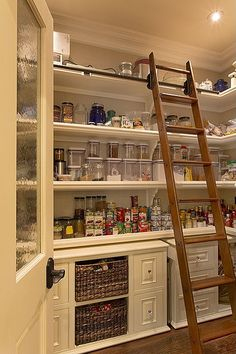 Reaching the upper shelf is a cinch in this well-organized pantry.