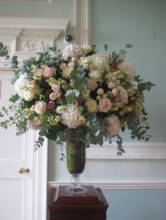 close up of the pedestals filled with white and pink hydrangeas, white and sweet avalanche roses, lisianthus,bombastic spray roses, astrantia and stock