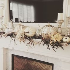 Pin for Later: How Girls on a Budget Are Styling Their Homes For Fall Real pumpkins mix with metallic HomeGoods pumpkins for elegant effect on this mantle.