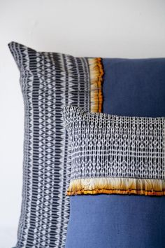 made with rebozo fabric that has been hand dyed and woven by the artisans of Tenancingo, these cotton and silk pillows sport a decorative macramé fringe