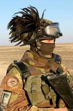 Italian soldier - Fashionistas in camo. Fredo, do you really need a feather in your helmet? You're damn right I do.