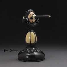 Spin top on matching stand made of Kalimantan Palm Nut, African Blackwoo, Tagua Nut & Pink Ivory Wood.
