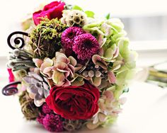 Antique Green Hydrangea accented with Raspberry Garden Roses and Moss Orbs