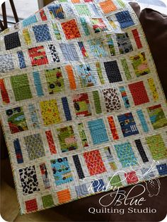 How cute would this be in little girl fabrics as well? Love it! Ruby Blue Quilting Studio: New Quilts: Aura & Tiny Bits