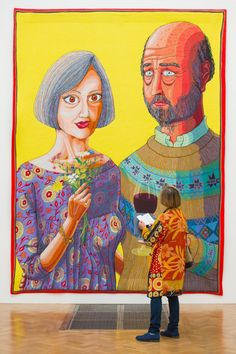 A visitor views 'Julie and Rob', by Grayson Perry, part of the Royal Academy of Arts Summer Exhibition 2015 which runs from June 8 until August 16 at the Royal Academy of Arts