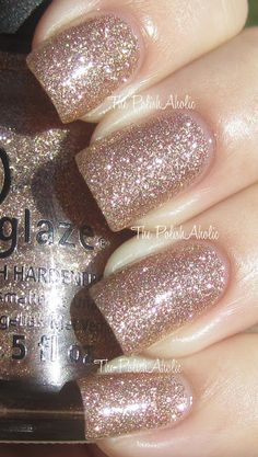 China Glaze Champagne Kisses is a tan, rose gold-ish glitter with a ton of holo glitter bits in the mix.