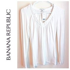 Banana Republic White Stretch Long Sleeve Tee New with tags. Stretchy v-neck long sleeve tee from Banana Republic. Color is white & would consider it more of a winter off white than bright white. Love the feel of the material on this. It's really soft & smooth. 92% modal, 8% spandex. Banana Republic Tops Tees - Long Sleeve
