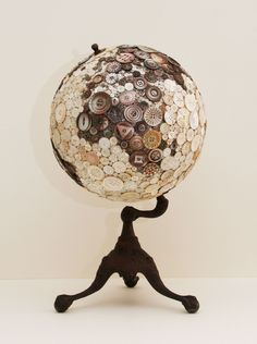 Robin Ayres – My largest button globe. All the buttons are carved mother of pearl and abalone. The buttons are all sewn on. Africa view