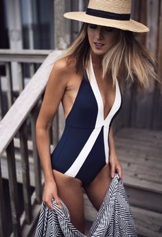 classic navy and white halter one piece swimsuit with plunge neckline and x front + straw boater hat