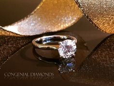 Love the timeless elegance of the round diamond solitaire
