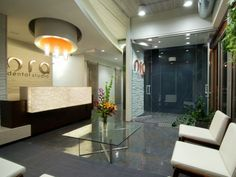 Dental Office Waiting Room. Reception desk/materials. Colors; clean presentation.