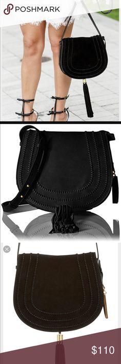🎉NWOT Vince Camuto Tassel Leather Crossbody Bag NWOT-never used. Vince Camuto 'Izzi' Cross-body Flap Bag. Beautiful black suede and leather high quality bag with brushed gold hardware. Saddle bag infused with western flair & tassel details. Cross body strap loops through the smooth leather edges, while 3 u-shaped bands weave through the suede flap. Magnetic snap closure. Inside has a zipper pocket & cell pocket. Outside back has magnetic snap pocket to easily access needed items. Crossbody…