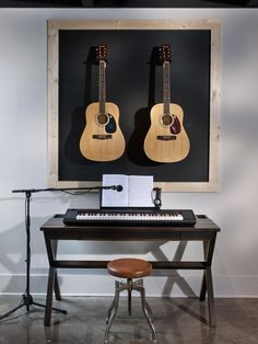 Musical instruments encourage inspiration, and two signed guitars by Willie Nelson and Billy Ray Cyrus hang on the wall, paying homage to the country music scene.