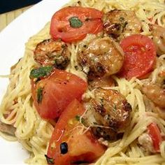 Grilled shrimp over angel hair pasta with melted mozzarella, basil, and tomatoes in a garlic butter sauce makes a delicious and easy meal. Seafood Dishes, Pasta Dishes, Seafood Recipes, Pasta Recipes, Dinner Recipes, Cooking Recipes, Healthy Recipes, Rice Pasta, Italian Dishes
