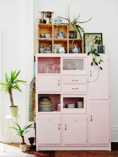 A pastel pink kitchen cabinet in Peter and Paula Mills home in Melbourne on The Design Files