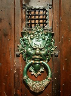 Ornate door knocker of Needful Things, an antique furniture and art business, in St James's Street, Kemp Town, Brighton, East Sussex.