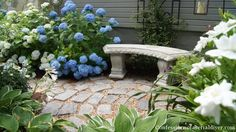 Front Yard Makeover One Year Later Confessions of a Serial DoitYourselfer This small patio was made from old granite landscaping stones and easier than you think to do Patio Circulaire, Side Yard Landscaping, Landscaping Ideas, Landscaping Software, Landscaping Blocks, Front Yard Decor, Circular Patio, Verge, Patio Makeover