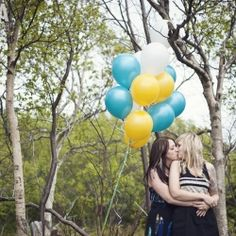 Adorable same sex couple's engagement shoot in downtown Newfoundland, with cupcakes, balloons and pops of yellow everywhere.