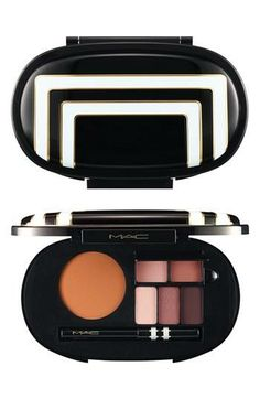 A range of coordinated MAC eyeshadows, bronzing powder, lipsticks and eye kohl are tucked into a mirrored compact.  #holidaygifts
