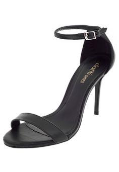 Sandália DAFITI SHOES Tornozelo Preta, com cabedal fosco, calcanhar fechado e salto agulha. Possui fechamento por tira no tornozelo com fivela de ajuste.