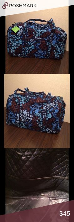 Vera Bradley Java Floral Large Duffel NWT Vera Bradley Large Duffel NWT. It has long straps and a slip in pocket on the end. There is a zippered pocket on the front and three mesh pocket inside. Zippered closure. This comes from a smoke free and pet free home! Vera Bradley Bags Travel Bags