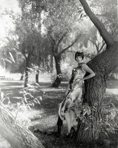 Louise Brooks in a forest.