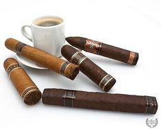 Short Winter Coffee Break Cigar Sampler featuring Tabak Especial, Nub Cafe Cappuccino, Drew Estate Java Maduro, Nub Cafe Espresso, and Natural by Drew Estate. Cigars And Whiskey, Pipes And Cigars, Nub Cigars, Cigar Sampler, Chocolate Cigars, Drew Estate, Juicy Lucy, Winter Coffee, Cigar Lighters
