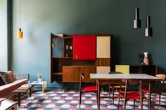 Milan Casa Base Hostel: A showcase of retro interior design | For more inspiration, you can visit our blog: www.essentialhome.eu/blog/ #MidCenturyModern #InteriorDesign #Inspiration