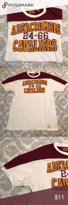 Abercrombie and Fitch, men's short sleeve T-shirt Abercrombie and Fitch men's short sleeve T-shirt. EUC. Little of stain on the inner top of collar as sworn in picture. Not to noticeable when worn. Size L. 100% Cotton. Multiple colors, maroon, white and gold Abercrombie & Fitch Shirts Tees - Short Sleeve