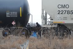 Officers from Ames Police Department and Union Pacific Railroad company investigate after an accident that a person hit by a train near North Dakota Avenue on the west side of Ames on Friday. Photo by Nirmalendu Majumdar/Ames Tribune http://www.amestrib.com/news/20170113/one-person-dead-after-being-struck-by-train