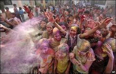 School children throw coloured powder as they celebrate Holi, the Indian festival of colours, in the Indian city of Ahmadabad. [bbc] by johnhanscom, via Flickr