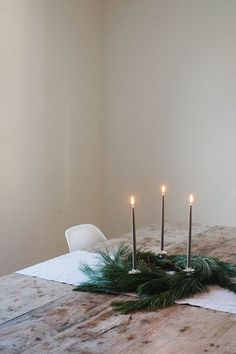 Simple Christmas tablescape with greenery and candlesticks