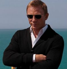 """Daniel Craig in Quantum of Solace shawl collar cardigan.  Cracks me up that it's described as """"grandpa chic"""".  I don't care; he looks hot.  <3"""