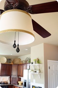 diy ceiling fan makeover  drum shade  tutorial   shows how to attach     would love to do this with our ugly light fixture fan in the our kitchen