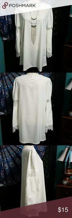 """FavoLook Tunic Adorable Off-White tunic with rough lace inserts & trim on bell sleeves. The pleated shoulder gives it a soft feminine look.  This tunic is beautiful paired with leggings and tall boots. Long necklaces also set this tunic off to give it whatever vibe your feeling, from sweet to badassy.  (Necklace not included) Measurements: Pit to pit 21"""" Shoulder to hem 32"""" FavoLook Tops Tunics"""