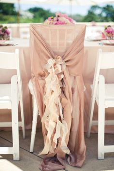 Wedding Chair Swag Decorations - A whimsical sheer fabric with ruffle creation makes for a beautiful wedding chair cover. #Wedding #Chair #Swag #Decoration