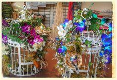 Gorgeous birdcage floral arrangements