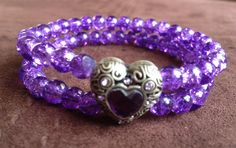 Purple crackle glass beads with silver toned heart slide. Double row stretch bracelet. Boho bracelet. Chic bracelet. Stretch bead bracelet. by BeadStrungOut on Etsy