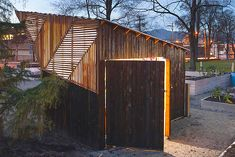 Brendan Callander, wooden shed, Woodlands Community Garden, Vancouver, charring, Shou Sugi Ban, burnt wood, lattice, Shou Sugi Ban, Air quality, Architecture, Green Materials, Daylighting,  Interesting use of wood and alignment - rooftop of shed. Inspiration for wooden fence?