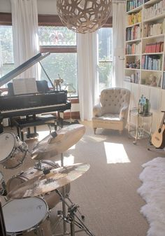 White-gray with gold accents and colorful floor to ceiling books, piano, and beautiful windows