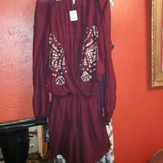 Free people jumper Deep wine color long sleeve but light fabric color says red cut out shoulders beaaaautiful! Free People Dresses